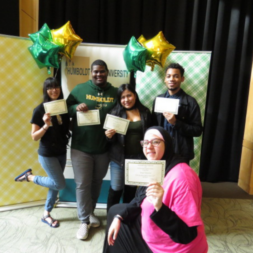 Students standing with certificates